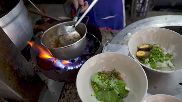Making Kuay Jab, noodle soup Thai street food.