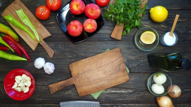 Making Mexican salsa Making salsa, the traditional Mexican sauce. Preparing the kitchen knife to chop the ingredients. Overhead view dipping sauce stock videos & royalty-free footage