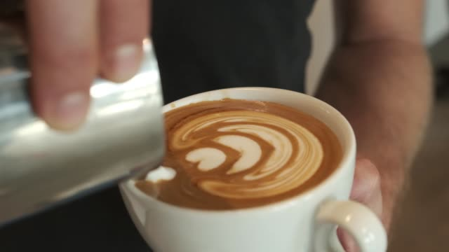 Making of a latte with tulip latte art in it