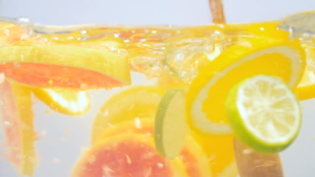 making of natural cocktail from limes, oranges and grapefruit. - healthy green juice video stock e b–roll