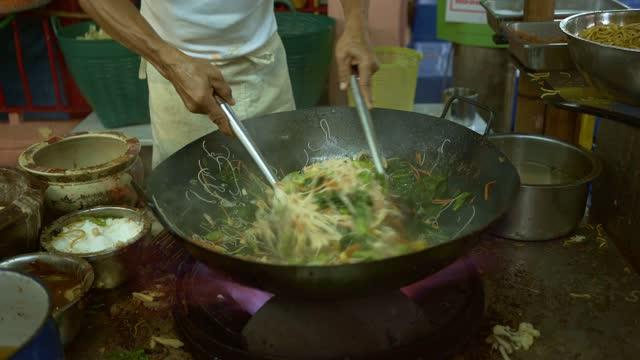 Making Pad Thai on night market - stock video