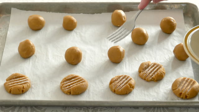Making Peanut Butter Cookies, Pressing, Baking Making Peanut Butter Cookies, preparation before baking. molding a shape stock videos & royalty-free footage