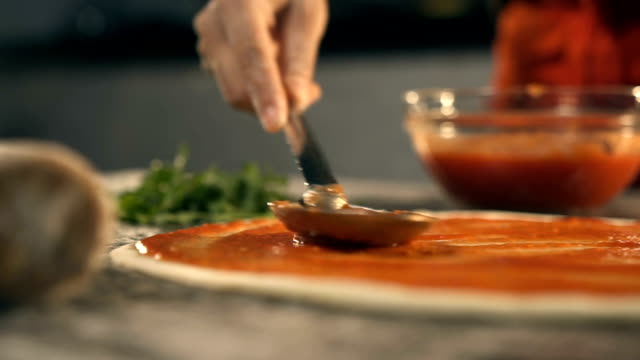 Making Pizza, Spreading Tomato Sauce Making Pizza, Spreading Tomato Sauce pizza stock videos & royalty-free footage