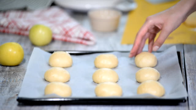 Making sweet buns in bakery. Raw unbaked buns. Making sweet buns in bakery. Raw unbaked buns. hot pockets stock videos & royalty-free footage