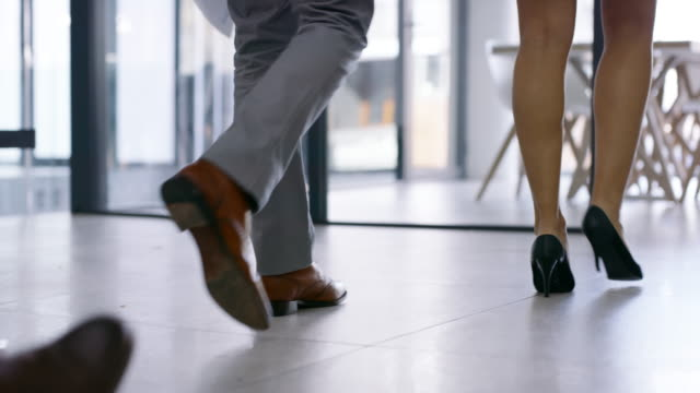 Making their way towards new opportunities 4k video footage of a group of businesspeople entering a boardroom in an office foot stock videos & royalty-free footage
