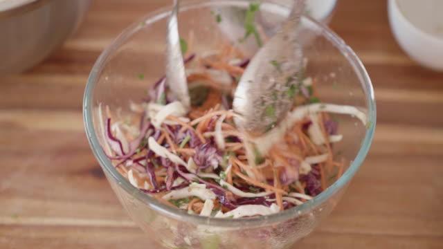 making vegan slaw in the kitchen video