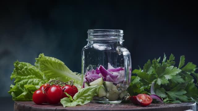 Making vegetable salad in mason jar video
