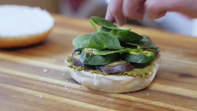 making vegetarian burger - melanzane video stock e b–roll