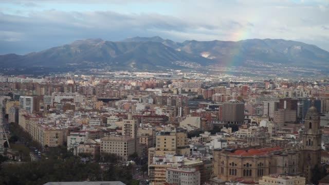 stockvideo's en b-roll-footage met malaga stadsgezicht met regenboog. uitzicht op malaga stadsgezicht. spanje - sportcompetitie
