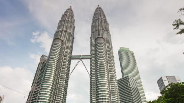 malaysia sunny day petronas twin towers kuala lumpur city center view 4k time lapse video
