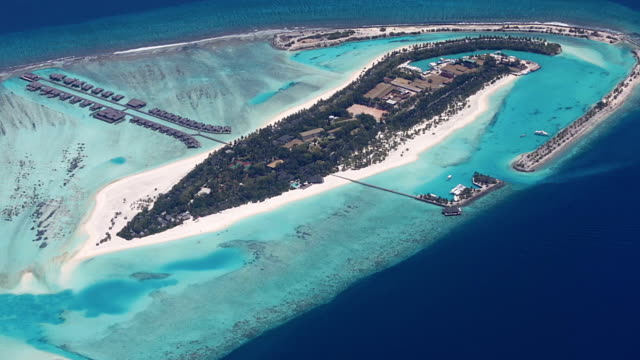 Maldives Island Aerial An Aerial video of a holiday resort Island in Maldives indian ocean islands stock videos & royalty-free footage