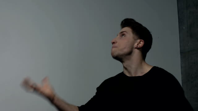 male actor facial expressions in studio: fury and rage - distrarre lo sguardo video stock e b–roll