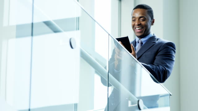 Male African American financial advisor using wireless tablet