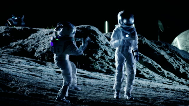 Male and Female Astronauts Wearing Space Suits Dance on the Surface of the Alien Planet. Humanity Colonizing Space Celebration Theme. video
