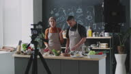 istock Male and Female Bloggers Recording Online Cooking Class 1298646512