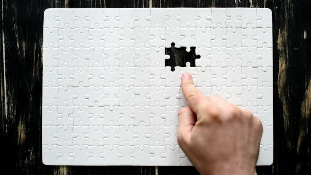 male and female hands  adds white puzzle video