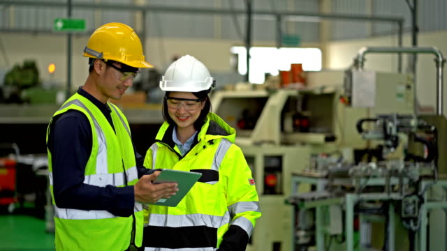 4K Male And Female Industrial Engineer Using A Digital Tablet Working In A Heavy Industry Manufacturing Factory 4K Male And Female Industrial Engineer Using A Digital Tablet Working In A Heavy Industry Manufacturing Factory manufacturing equipment stock videos & royalty-free footage