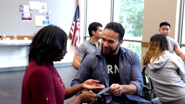 Male and female military veterans discuss services for veterans Mid adult African American female veteran and mid adult Hispanic male veterans discuss events and services for veterans while spending time in a community center. veteran stock videos & royalty-free footage