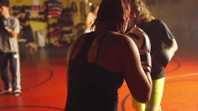 Male and Female Spar in Gym video
