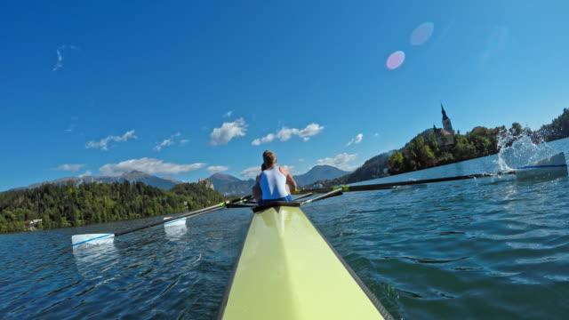 POV Male athlete and his team mates rowing on the lake in sunshine video