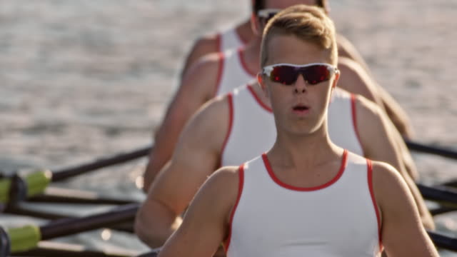SLO MO Male athlete during sculling with his team mates video