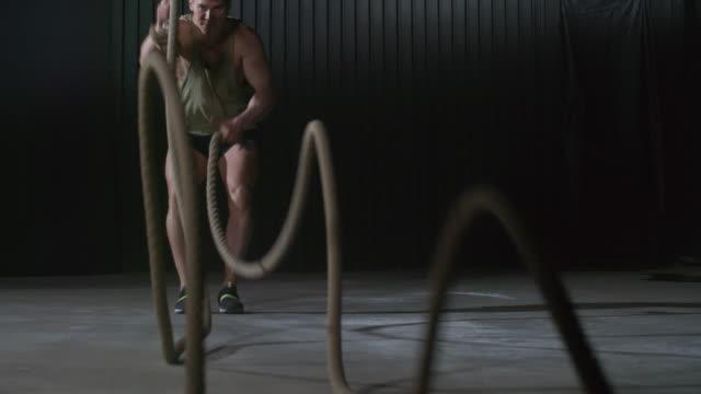 Male Athlete Using Battle Ropes