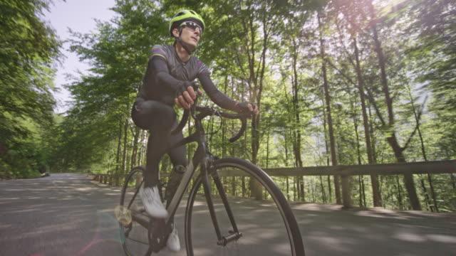 ts male biker riding his road bike up the nice mountain road - passo montano video stock e b–roll