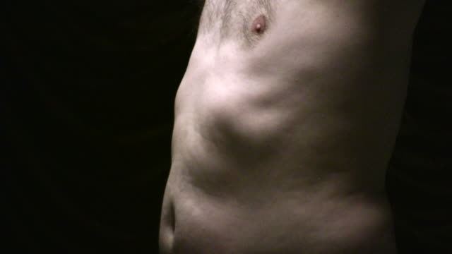 (HD1080i) Male Body Issues: Torso, Stomach, Ribs, Chest in Light video