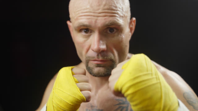 male boxer raises fists - mma stock videos and b-roll footage