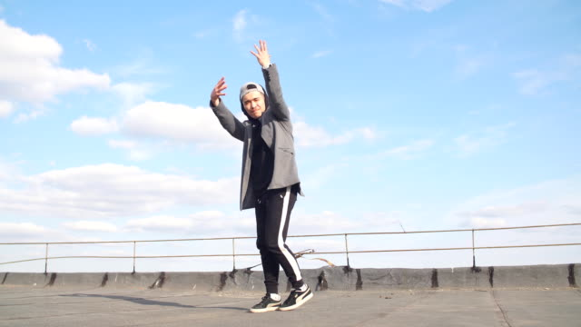 Male breakdancer dancing in urban surroundings