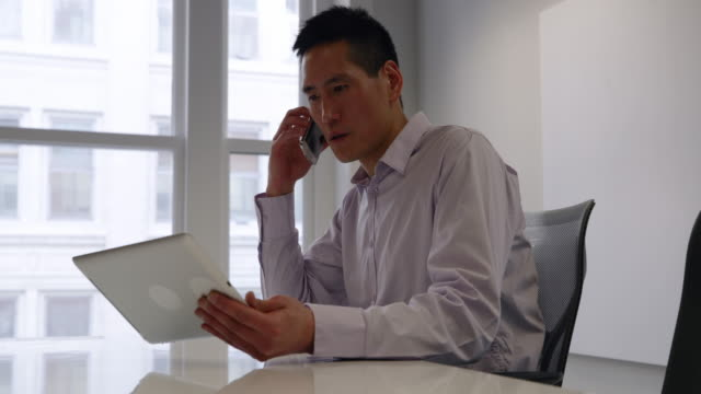 Video Male business professional working in a modern office