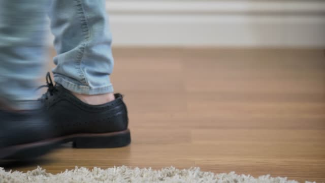 Male Caucasian feet in jeans and broggi shoes coming into shot, stopping, and leaving. Man in elegant boots. Lifestyle, fashion. Male Caucasian feet in jeans and broggi shoes coming into shot, stopping, and leaving. Man in elegant boots. Lifestyle, fashion. stamping feet stock videos & royalty-free footage