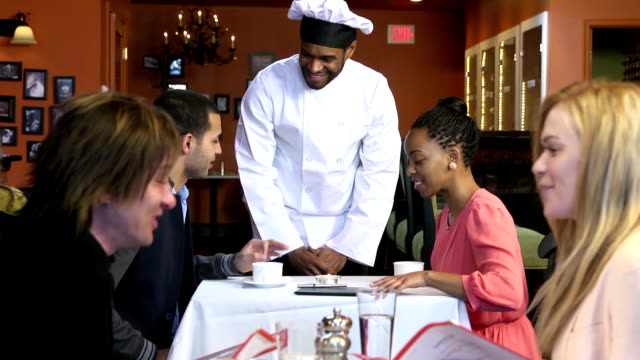 Male Chef Greets Patrons in Busy Restaurant video