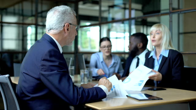 Male company director slamming hand table feeling tired of shouting colleagues Male company director slamming hand table feeling tired of shouting colleagues obedience stock videos & royalty-free footage