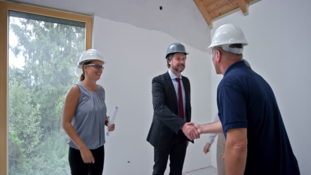 Male construction supervisor meeting the investors in their future home