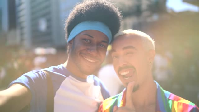 Male couple taking a selfie during LGBTQI parade video