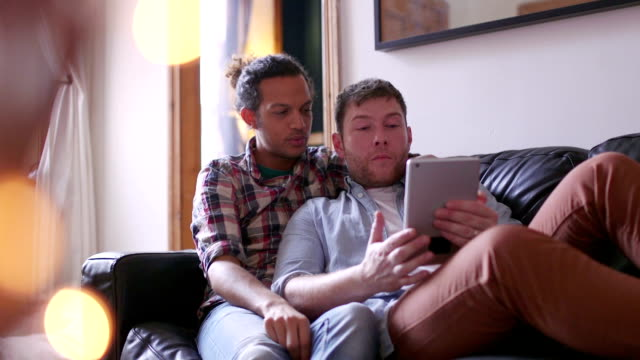 male couple using digital tablet - same sex couples stock videos and b-roll footage