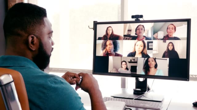 Male creative professional brainstorms ideas with colleagues during virtual meeting
