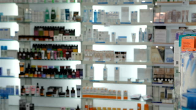 Male customer chooses some medicine at the drugstore video