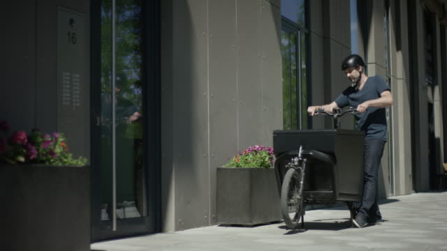 Male cycle messenger delivering packages video