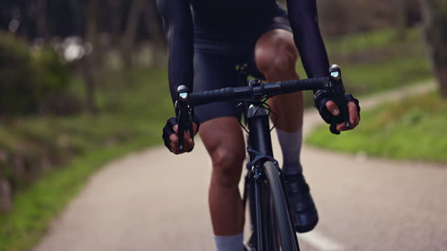 Male cyclist riding professional bicycle with black handlebars Closeup of male cyclist riding professional bicycle gripping black handlebars handlebar stock videos & royalty-free footage