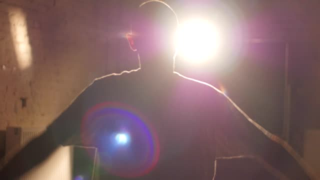 Male dancer warming up in backlight video