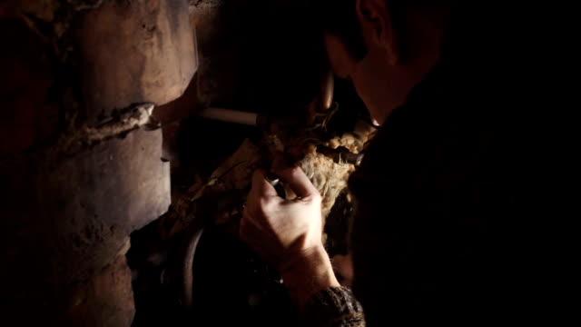 Male DIY Fixing A Water Tank In Attic video