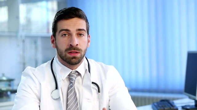 Male Doctor Talking At The Camera video
