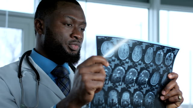Male doctor viewing mri picture video