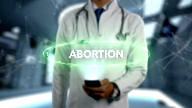 Abtreibung - männlichen Arzt mit Handy öffnet und Hologramm Behandlung Wort berührt – Video