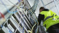 istock LD Male electrician working on a new electrical enclosure 1141915423