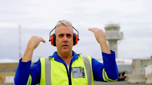 Male engineer gesturing in airport 4k