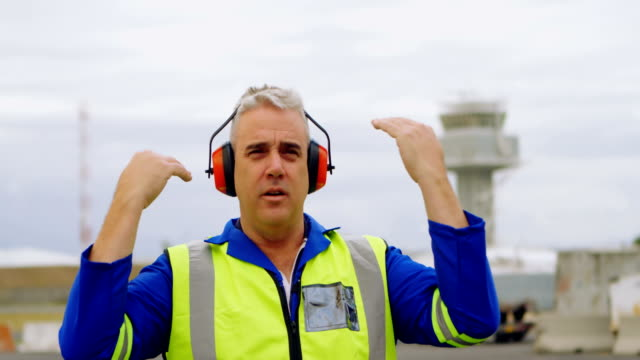 Male engineer gesturing in airport 4k Mature male engineer gesturing in airport 4k guidance stock videos & royalty-free footage