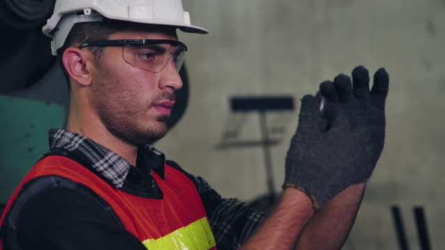 Male engineer inspect the goods Male engineer inspect the goods manufacturing equipment stock videos & royalty-free footage